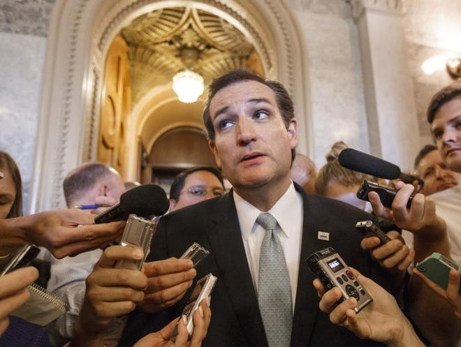 """U.S. Sen. Ted Cruz, R-Texas, spoke with reporters after his overnight crusade railing against the Affordable Care Act, popularly known as """"Obamacare,"""" at the Capitol in Washington, Wednesday, Sept. 25, 2013. Cruz and other conservative Republicans are trying to delay a must-pass spending bill."""