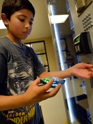 Jeremy Montero, 12, pulls a snack from a Dynamic Healthy