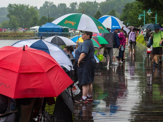 Spectators wait on the waterfront boardwalk for the rain delay to end and the Wings Over Vermont air show to begin in Burlington on Saturday, August 13, 2016.