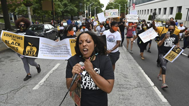 Educators march on Central Avenue heading Liberty Plaza, Friday, June 26, 2020, in Atlanta. The Educators for Black Lives March started at 3 p.m. at Rosa L. Burney Park on Windsor Street south of downtown. Organizers planned brief stops outside the city jail, the headquarters for Atlanta Public Schools, the Georgia Department of Education, and Atlanta City Hall, before arriving at their destination: Liberty Plaza across the street from the Georgia State Capitol.