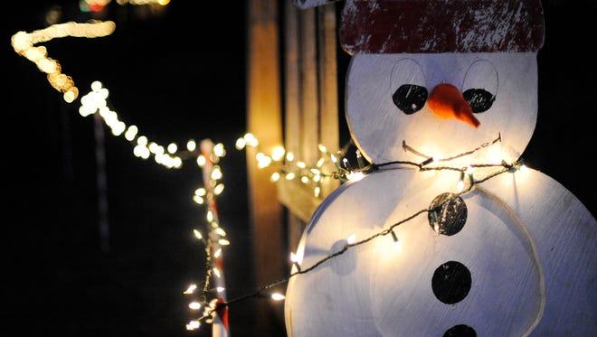 In this HTR Media file photo, a painted, wooden snowman greets visitors as the lights behind it lead through Camp Sinawa during their annual Christmas at Sinawa event.