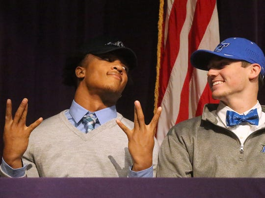 Smyrna football players Casey Perkins, left, who signed with Old Dominion and John Turner, who signed with MTSU on National Signing Day, on Wednesday, Feb. 1, 2017, will soon be football rivals.