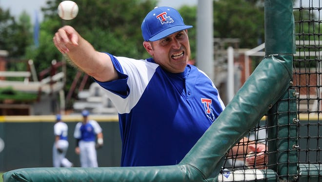 Louisiana Tech coach Greg Goff throws batting practice Thursday at Dudy Noble Field in Starkville, Mississippi, cite of this weekend's NCAA Regionals.