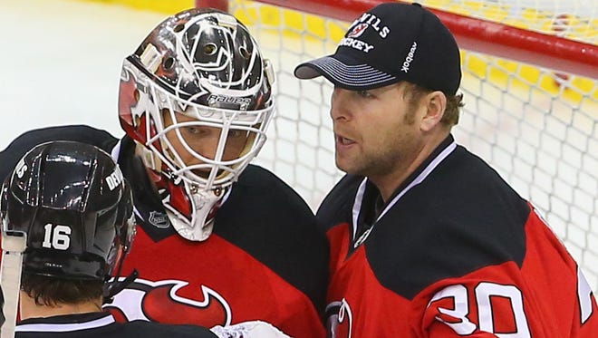 Devils goalie Cory Schneider, left, wants to have 60 starts next season and Martin Brodeur plans to test the free-agent market.