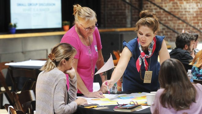 Dana Mauriello of Etsy, standing at right, takes part in a brainstorming session with local entrepreneurs Laurel Kiewitt, left, Crystal Lynn Sharp, and Kathy Seely during the Knoxville Maker City Summit Monday, Sept. 19, 2016, at the Mill and Mine, 227 W. Depot Ave. The summit kicks off Innov865 Week which is focused on connecting startup businesses with sources of expertise and capital. Etsy, an online marketplace for handmade items, has named Knoxville one of 13 Etsy Maker Cities, places that support micro-entrepreneurs. (PAUL EFIRD/NEWS SENTINEL)