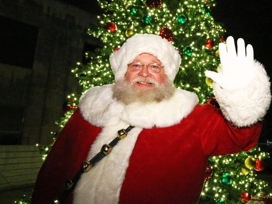 Santa waves hello to all the guests during the 16th