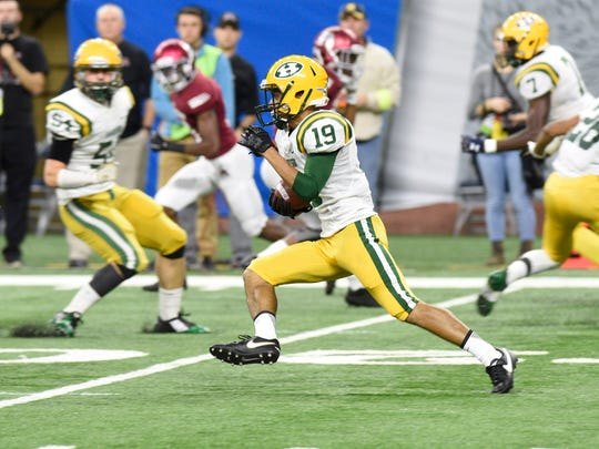 Farmington Harrison's Ben Williams returns the opening kickoff for a TD to give the Hawks an early 7-0 lead.