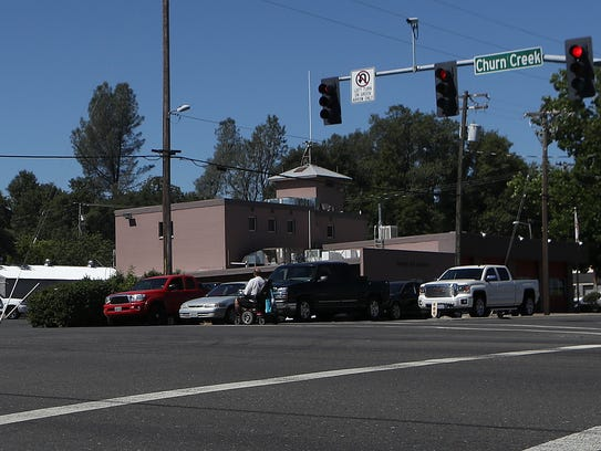 A man crosses a busy intersection at Churn Creek Road