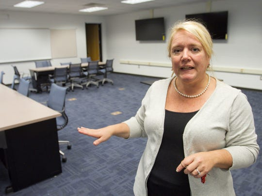 """Cindy Millns, cyber curriculum and instruction specialist, talks about how the """"cyber range hub,"""" established inside Pinckney Community High School, will function."""