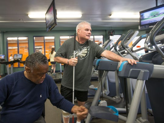 Ronnie Felton helps Bruce Drainer find an elliptical