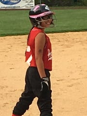 In this handout photo Isabella Mu–oz,12, playing during a softball softball in Haverstraw.
