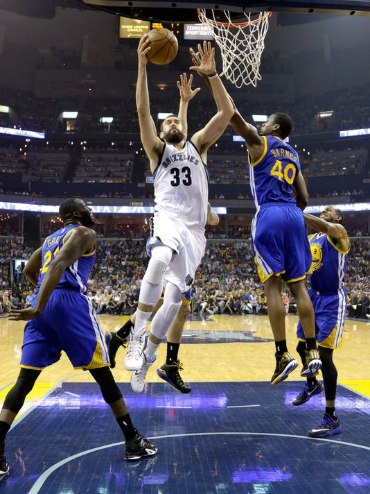 Memphis Grizzlies center Marc Gasol (33), of Spain, drives to the basket past Golden State Warriors' defenders Harrison Barnes (40) and Draymond Green (23) in the first half of Game 6 of a second-round NBA basketball Western Conference playoff series Friday, May 15, 2015, in Memphis, Tenn. The Warriors won 108-95 to win the series 4-2. (AP Photo/Mark Humphrey)