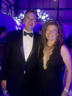 Dr. Paige Tabor meets with Governor Steve Bullock, of Montana, at the inaugural ball following his reelection. Dr. Tabor is a Safety Officer/HR Trainer in