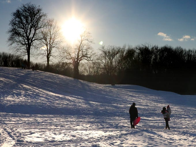 A young family heads up the Whitnall Park Golf Course