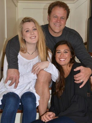 Former Vanderbilt running back Brad Gaines with his daughters Riley, left, a two-time swimming state champion, and Taylor., a standout softball pitcher.
