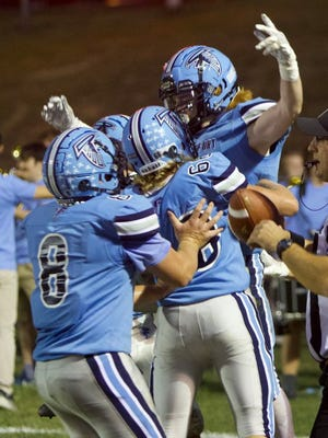 Frankfort celebrates a TD against Spring Mills Friday at Falcon Stadium. Tribune photo by Lee Brown/knobley.com