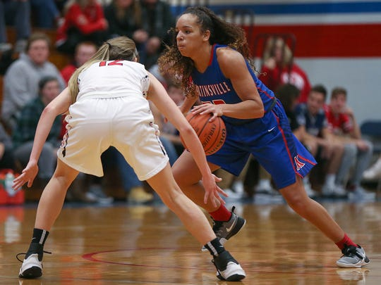 Center Grove Trojans guard Emma Utterback (12) guards Martinsville Artesians Kayana Traylor (23) during second half action at Martinsville High School in Martinsville, Ind., Wednesday, Feb. 1, 2017.