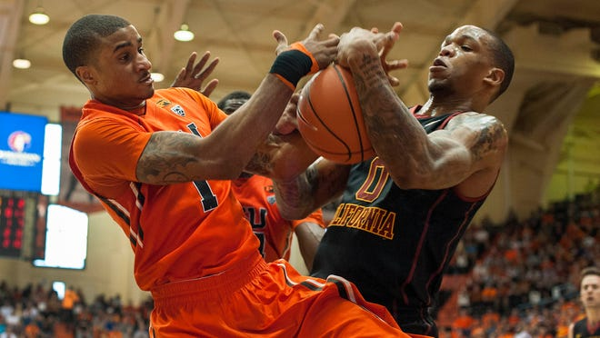 Jan 24, 2015; Corvallis, OR, USA; Oregon State Beavers guard Gary Payton II (left) and USC Trojans forward Darion Clark (right) tussle for control of the ball during the second half of the game at Gill Coliseum. The Beavers won 59-55. Mandatory Credit: Godofredo Vasquez-USA TODAY Sports