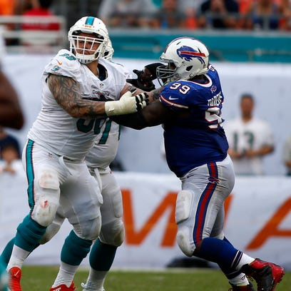 Dolphins guard Richie Incognito, left, blocks Bills defensive tackle Marcell Dareus in a 2013 game.