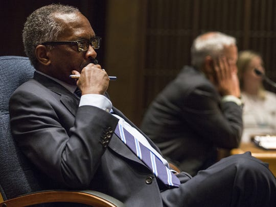 County Councilman Penrose Hollins listens to speakers