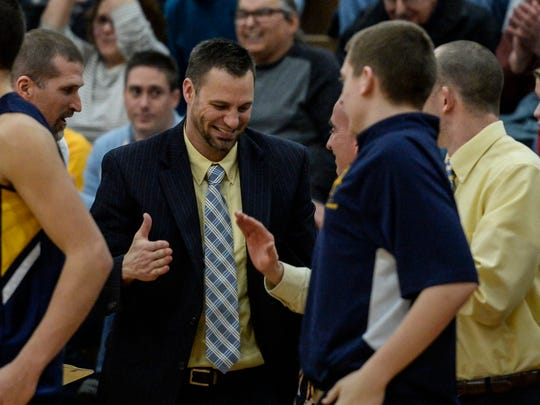 Elco head coach Brad Connors celebrates after the Raiders'