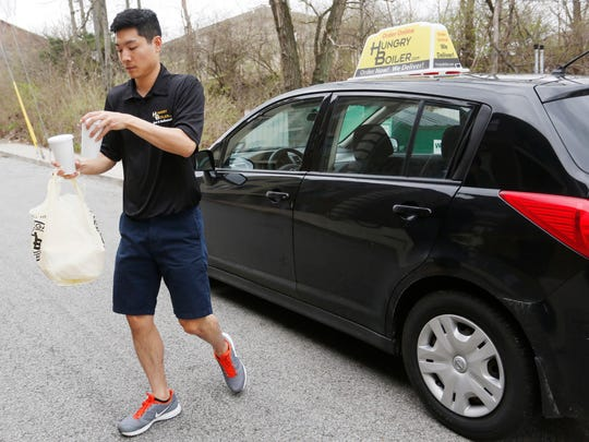 HungryBoiler driver Eric Koo delivers an order from