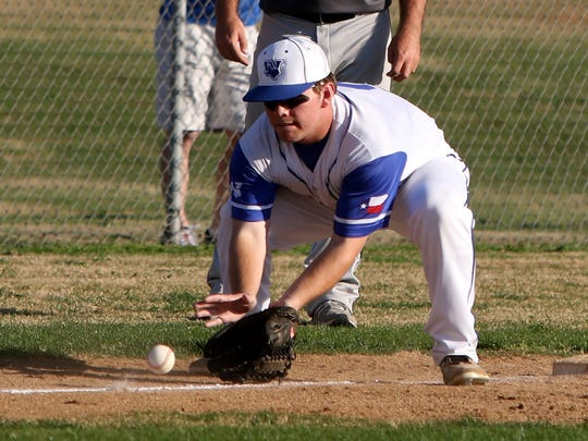 Windthorst's Tristan McQuerry fields the groundball in the game against Petrolia Monday, March 20, 2017, in Windthorst. The Trojans defeated the Pirates 1-0.