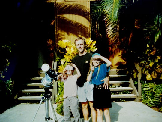 Mark Manner in Hawaii July 11, 1991, on the Big Island Kona Coast with his son, John, 8, left, and his daughter, Virginia, 11. Totality lasted 4 minutes 8 seconds that day.