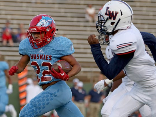 Hirschi's Isaiah Esquibel runs upfield in the game