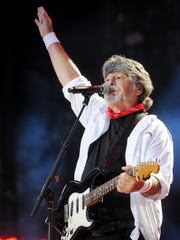 Randy Owen of Alabama performs for the packed audience
