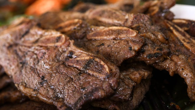 Beef short ribs, marinated for four days, grilled over hot charcoal coals, then served up on the buffet line at Bubba's Grill in Tamuning on Friday, May 19, 2017.