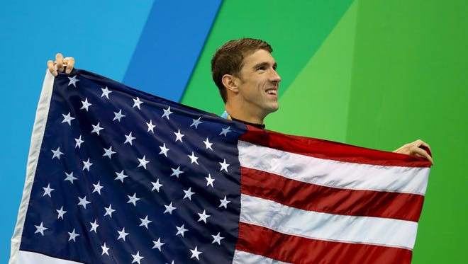 Gold medalist Michael Phelps of the United States poses during the medal ceremony for the Men's 4 x 100m Medley Relay Final on Day 8 of the Rio 2016 Olympic Games at the Olympic Aquatics Stadium on August 13, 2016 in Rio de Janeiro, Brazil.