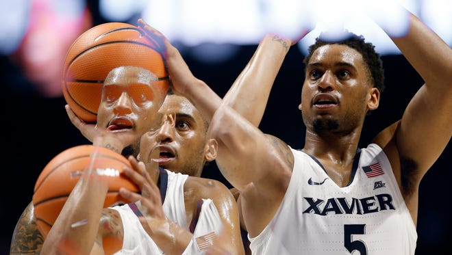 (multiple exposure) Xavier Musketeers guard Trevon Bluiett (5) shoots free throws in the second half of the NCAA Big East Conference basketball game between the Xavier Musketeers and the Seton Hall Pirates at the Cintas Center in Cincinnati on Thursday, Feb. 15, 2018. Xavier held on to its halftime lead to clench a 102-90 win over the Pirates.