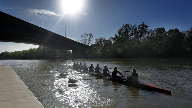 Rowers from the Genesee Rowing Club leave the dock for practice at the confluence of the Genesee River and Erie Canal at Genesee Valley Park in Rochester.