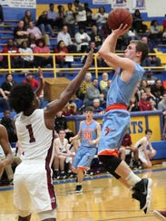 South Gibson's Nathan Hicks pulls up for a shot during