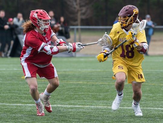 Salisbury University's Corey Gwin (18) moves the ball