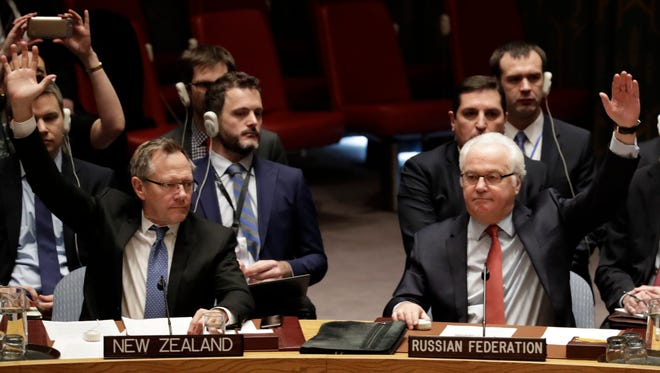 New Zealand ambassador to the United Nations, Gerard Jacobus van Bohemen, left, and Russian ambassador to U.N., Vitaly Churkin, right, are seen during a vote on a cease-fire in Syria at U.N. headquarters in New York on Dec. 31, 2016.