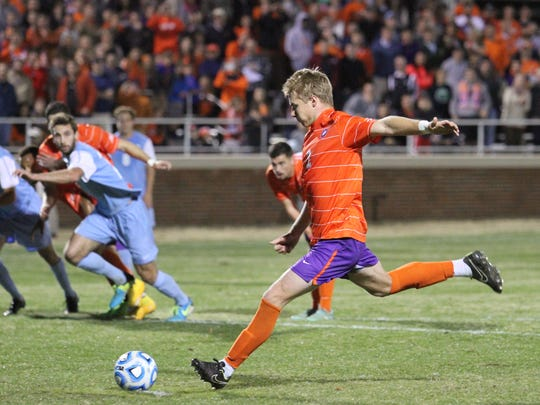 DAWSON POWERS/Contributer Kyle Fisher scores on a penalty kick against North Carolina in the quarterfinals of the NCAA Tournament on Sunday at Historic Riggs Field. Kyle Fisher (2) scores on a penalty kick in the first half against North Carolina in the Quarterfinals of the NCAA Tournament at Historic Riggs Field, November 30th, 2014.