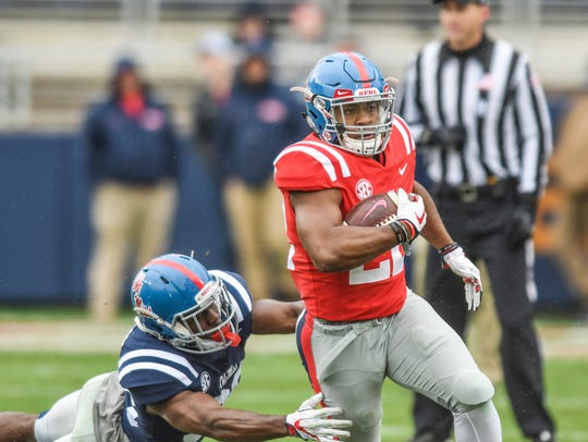 Ole Miss running back Scottie Phillips (22) is chased