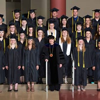 The 2014-2015 Associates of Arts and Science and Bachelor of Applied Arts and Sciences graduates pose with Dean and Campus Executive Officer Patricia Stuhr.
