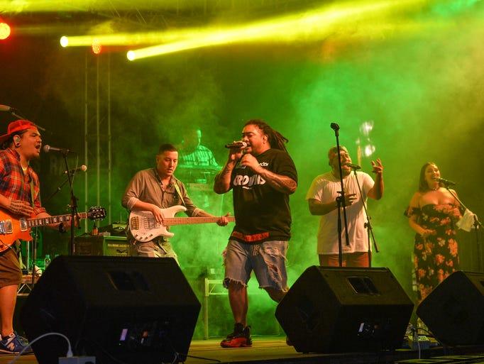 Boog performs during a concert at Guam Greyhound