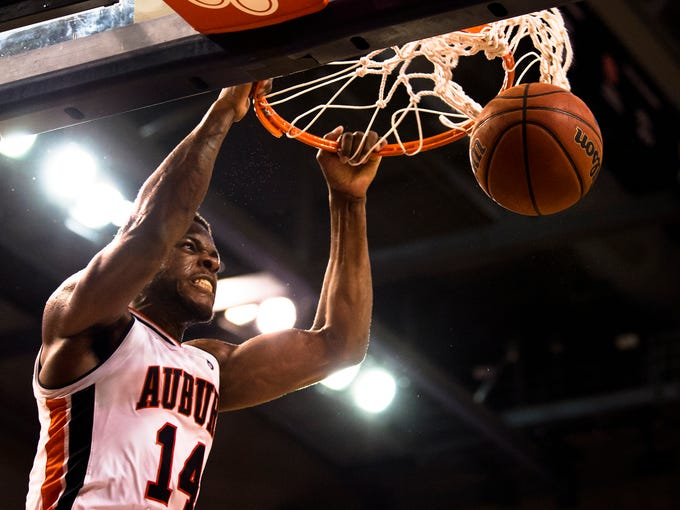 Auburn Tigers guard Malik Dunbar (14) dunks during