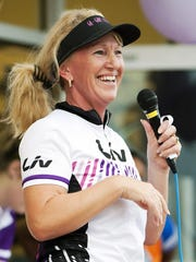 Lynne Sharp, co-owner of Go Girl Cycling in Fort Myers, begins the Global Solidarity Ride in Fort Myers on Sunday.