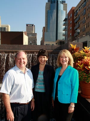 """The leaders of Confluence, Alan Vicory and Melinda Kruyer (right), pose in a 2012 photo with Sally Gutierrez, director of environmental technology innovation cluster development and support program for the U.S. Environmental Protection Agency. Vicory and Kruyer run Confluence and partner with the EPA to create jobs and put Cincinnati on the map as a hub for water technology, maybe even make us the """"Silicon Valley of water."""""""