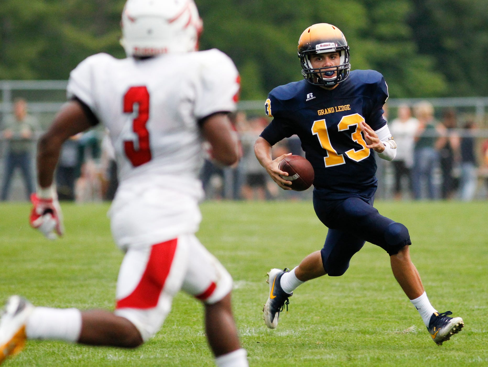 Grand Ledge QB Nolan Bird runs against Sexton's Cody Blaneburg September 9, 2016, at Grand Ledge. Bird led his Comets to a 40-19 win over Sexton. [MATTHEW DAE SMITH | for the Lansing State Journal]