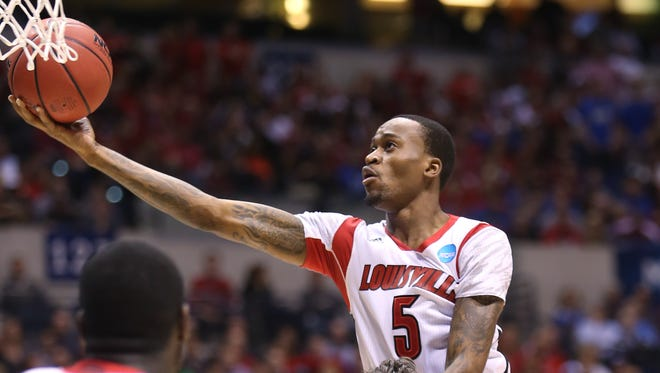 Louisville player Kevin Ware shoots for two in the first half against Duke. Ware broke his leg later in the NCAA Men's Regional basketball Final at Lucas Oil Stadium on Sunday, March 31 2013.