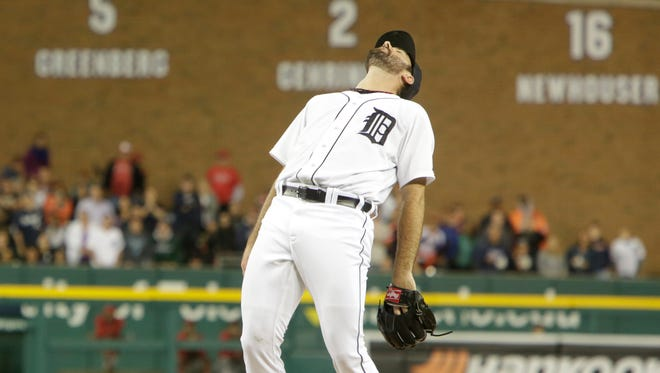 Tigers pitcher Justin Verlander reacts to giving up his first hit a double by Angels catcher Chris Iannetta in ninth inning on Wednesday at Comerica Park.