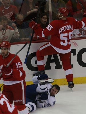 Red Wings defenseman Niklas Kronwall makes a hit on the Lightning's Nikita Kucherov during the second period of the Wings' 5-2 loss in Game 6 Monday at Joe Louis Arena.