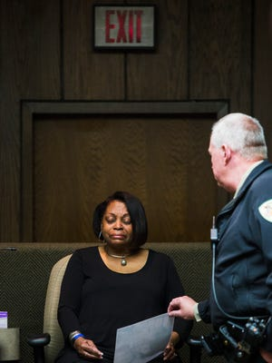 January 24, 2017 - Vivian Woods, mother of slain Memphis police officer Martoiya Lang, weeps after identifying her daughter from an autopsy photo during the opening day of Treveno Campbell's murder trial at the Shelby County Criminal Justice Center on Tuesday. Campbell is charged with killing Lang in 2012.