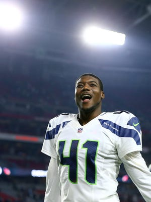 Seattle Seahawks cornerback Byron Maxwell (41) reacts after a game against the Cardinals at University of Phoenix Stadium in Glendale on Dec. 21. The Seahawks defeated the Cardinals 35-6.